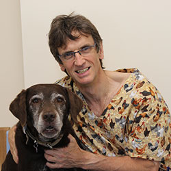 Ian with an elderly labrador